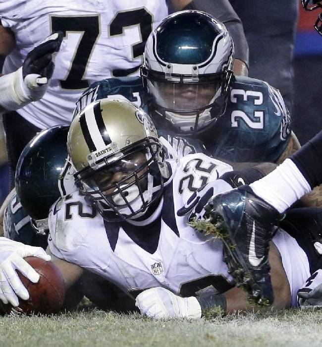 New Orleans Saints' Mark Ingram (22) scores a touchdown as Philadelphia Eagles' Patrick Chung (23) defends during the second half of an NFL wild-card playoff football game, Saturday, Jan. 4, 2014, in Philadelphia