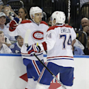 Montreal Canadiens left wing Rene Bourque (17) celebrates with teammate Alexei Emelin (74), of Russia, after scoring against the Tampa Bay Lightning during the third period of Game 2 of a first-round NHL hockey playoff series on Friday, April 18, 2014, in
