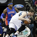Minnesota Timberwolves' Kevin Love, right, drives past Detroit Pistons' Josh Smith in the second half of an NBA basketball game, Friday, March 7, 2014, in Minneapolis. The Timberwolves won 114-101. Love led the Timberwolves with 28 points and 14 rebounds