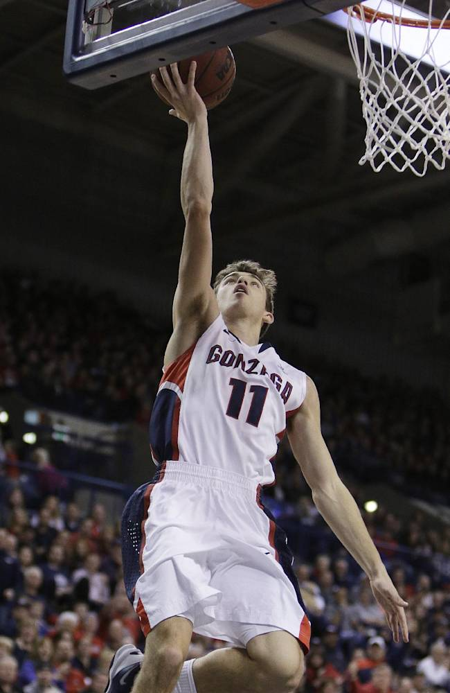 Gonzaga's David Stockton (11) attempts a layup during the first half of an NCAA college basketball game against Santa Clara on Saturday, Dec. 28, 2013, in Spokane, Wash