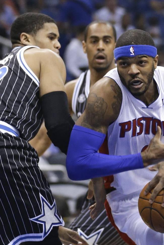 Detroit Pistons' Josh Smith, right, drives to the basket past Orlando Magic's Tobias Harris during the first half of an NBA basketball game in Orlando, Fla., Wednesday, Feb. 5, 2014
