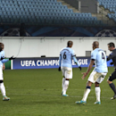 Manchester City's players react as Referee Istvan Vad points on the penalty spot during the Group E Champions League match between CSKA Moscow and Manchester City at Arena Khimki stadium in Moscow, Russia, Tuesday, Oct. 21, 2014