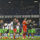 Wolfsburg's Ricardo Rodriguez, left, stands with teammates as they applaud supporters after their team's 4-1 loss to Everton in their Europa League Group H soccer match at Goodison Park Stadium, Liverpool, England, Thursday Sept. 18, 2014