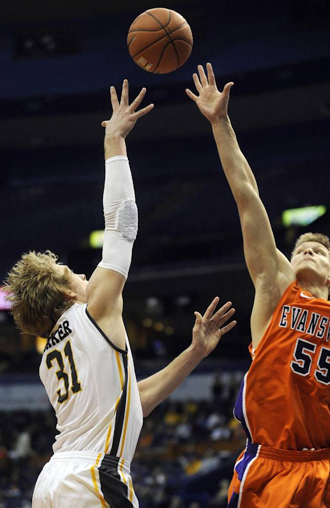 Wichita State's Ron Baker (31) shoots over Evansville's Egidijus Mockevicius (55) in the second half of an NCAA college basketball game in the quarterfinals of the Missouri Valley Conference men's tournament, Friday, March 7, 2014  in St. Louis