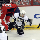 Pittsburgh Penguins center Sidney Crosby (87) looks for the puck against Washington Capitals center Jay Beagle (83) during the third period of an NHL hockey game, Monday, March 10, 2014, in Washington. The Penguins won 3-2 The Associated Press