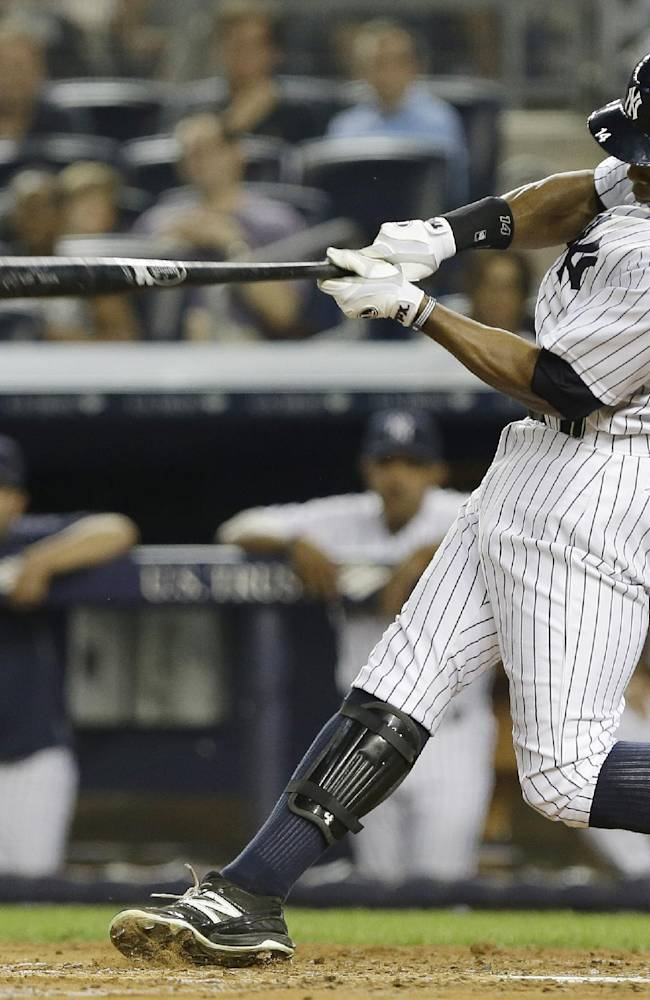 In this Aug. 21, 2013 file photo, New York Yankees' Curtis Granderson hits an RBI single during the third inning of a baseball game against the Toronto Blue Jays, in New York. A person familiar with the situation says free-agent outfielder Granderson and the New York Mets have agreed to a $60 million, four-year contract. The person spoke to The Associated Press on condition of anonymity Friday, Dec. 6, 2013,  because the deal was pending a physical and no announcement had been made