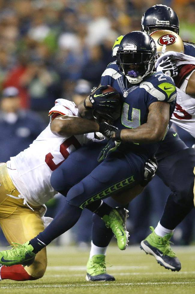 Seattle Seahawks' Marshawn Lynch, center, rushes against the San Francisco 49ers in the second half of an NFL football game, Sunday, Sept. 15, 2013, in Seattle. The Seahawks won 29-3