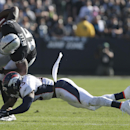 Oakland Raiders fullback Marcel Reece (45) is tackled by Denver Broncos strong safety T.J. Ward (43) during the first quarter of an NFL football game in Oakland, Calif., Sunday, Nov. 9, 2014 The Associated Press