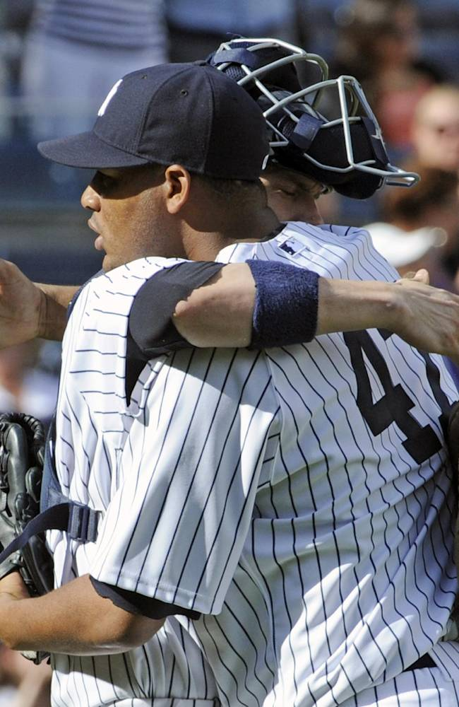 New York Yankees pitcher Ivan Nova (47) hugs catcher Chris Stewart after Nova pitched a complete game shutout as the Yankees defeated the San Francisco Giants, 6-0 in an interleague baseball game Saturday, Sept. 21, 2013, at Yankee Stadium in New York