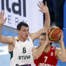 Latvia's Janis Berzins, left, challenges for the ball with Croatia's Bojan Bogdanovic, during their EuroBasket European Basketball Championship semifinal match in Ljubljana, Slovenia, Friday, Sept. 20, 2013. (AP Photo/Darko Bandic)