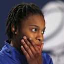 Kentucky guard A'dia Mathies listens to a reporter's question during a news conference before practice for a regional championship game of the women's NCAA college basketball tournament in Bridgeport, Conn., Sunday, March 31, 2013. Kentucky will play Connecticut Monday. (AP Photo/Charles Krupa)