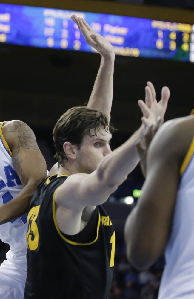 UCLA guard Norman Powell, left, passes around Arizona State center Jordan Bachynski to UCLA center Tony Parker during the second half of an NCAA college basketball game in Los Angeles, Sunday, Jan. 12, 2014