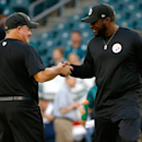 Philadelphia Eagles head coach Chip Kelly, left, and Pittsburgh Steelers head coach Mike Tomlin meet before an NFL preseason football game, Thursday, Aug. 21, 2014, in Philadelphia The Associated Press