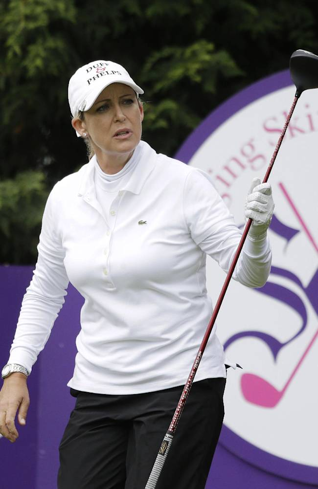 Cristie Kerr follows her shot that went out of bounds off the 13th tee of the Lake Merced Golf Club during the first round of the Swinging Skirts LPGA Classic golf tournament Thursday, April 24, 2014, in Daly City, Calif