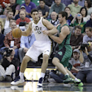Boston Celtics' Kris Humphries, right, defends against Utah Jazz's Enes Kanter (0), of Turkey, in the second quarter of an NBA basketball game Monday, Feb. 24, 2014, in Salt Lake City. The Jazz won 110-98 The Associated Press