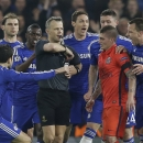 FILE - In this Wednesday, March 11, 2015 file photo Chelsea players remonstrate with referee Bjorn Kuipers just before he showed a red card to PSG's Zlatan Ibrahimovic during the Champions League round of 16 second leg soccer match between Chelsea and Par