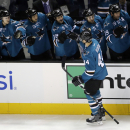 San Jose Sharks defenseman Marc-Edouard Vlasic (44) celebrates his goal with teammates on the bench during the first period of an NHL hockey game against the Winnipeg Jets on Saturday, Oct. 11, 2014, in San Jose, Calif The Associated Press