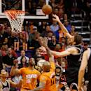 PHOENIX, AZ - JANUARY 30:  Pau Gasol #16 of the Chicago Bulls puts up a shot over P.J. Tucker #17 and Markieff Morris #11 of the Phoenix Suns during the second half of the NBA game at US Airways Center on January 30, 2015 in Phoenix, Arizona. The Suns defeated the Bulls 99-93. NOTE TO USER: User expressly acknowledges and agrees that, by downloading and or using this photograph, User is consenting to the terms and conditions of the Getty Images License Agreement.  (Photo by Christian Petersen/Getty Images)