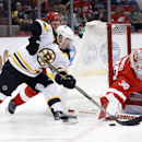 Detroit Red Wings goalie Jimmy Howard (35) stops a shot by Boston Bruins left wing Brad Marchand (63) as Detroit defenseman Niklas Kronwall (55), of Sweden, also defends in the first period of an NHL hockey game in Detroit, Wednesday, Oct. 15, 2014 The As