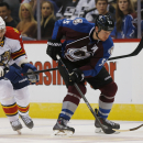 Florida Panthers left wing Jussi Jokinen, left, of Finland, uses his stick to slow down Colorado Avalanche left wing Cody McLeod as he works the puck down the ice in the third period of the Panthers' 4-3 overtime win in an NHL hockey game in Denver on Tue
