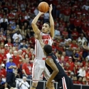 New Mexico's Kendall Williams shoots over San Diego State's Xavier Thames during the first half of a Mountain West Conference tournament NCAA college basketball game on Friday, March 15, 2013, in Las Vegas. (AP Photo/Isaac Brekken)