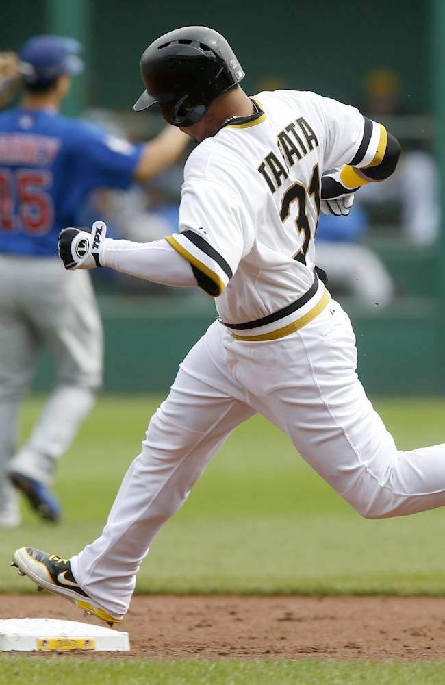 Pittsburgh Pirates' Jose Tabata (31) rounds third in front of Chicago Cubs second baseman Darwin Barney (15) on his way to a triple in the first inning of the baseball game on Sunday, Sept. 15, 2013, in Pittsburgh