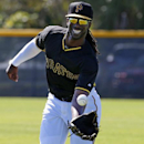Pittsburgh Pirates' Andrew McCutchen makes a catch during an outfielders drill at the baseball team's spring training workout in Bradenton, Fla., Thursday, Feb. 20, 2014 The Associated Press