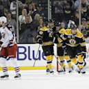 Boston Bruins center David Krejci (46), of the Czech Republic, Torey Krug, and Milan Lucic (17) celebrate as Columbus Blue Jackets defenseman Fedor Tyutin (51), of Russia, skates away after Milan Lucic scored a goal during the first period of an NHL hocke