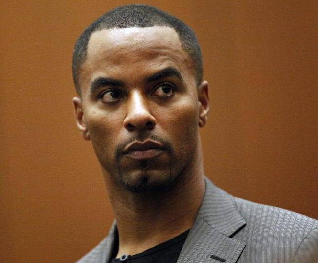 Former NFL safety Darren Sharper appears in Los Angeles Superior Court on Thursday, Feb. 20, 2014, in Los Angeles. Sharper has pleaded not guilty to charges that he drugged and raped two women he met at a West Hollywood night club