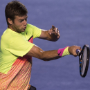 Ryan Harrison of U.S. returns the ball to David Ferrer of Spain during a Mexican Tennis Open semifinal match in Acapulco, Mexico, Friday, Feb. 27, 2015. (AP Photo/Christian Palma)