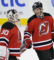 New Jersey Devils goaltender Martin Brodeur, left, celebrates with Jaromir Jagr, of the Czech republic, after an NHL hockey game against the Tampa Bay Lightning, Saturday, Dec. 14, 2013, in Newark, N.J. Brodeur stopped 33 Lightning shots as the Devils won 3-0. (AP Photo/Bill Kostroun)