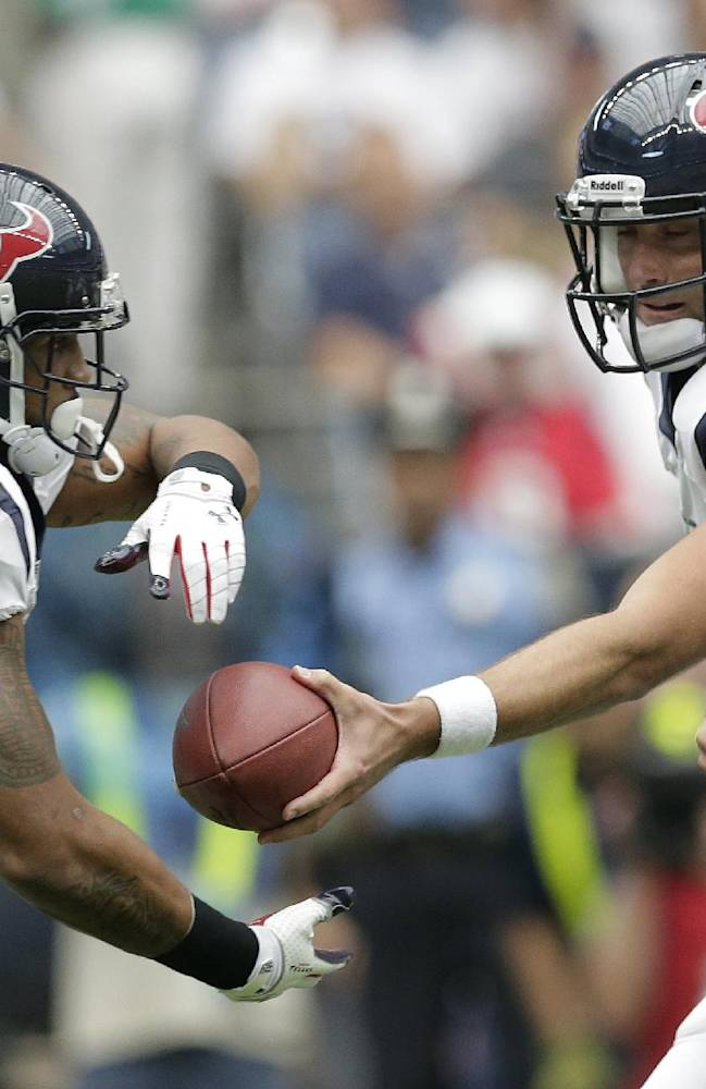 Houston Texans' Matt Schaub (8) hands off to Arian Foster (23) during the first quarter of an NFL football game against the Tennessee Titans, Sunday, Sept. 15, 2013, in Houston