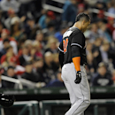 Miami Marlins' Giancarlo Stanton (27) walks away after he struck out during the eighth inning of a baseball game against the Washington Nationals, Tuesday, April 8, 2014, in Washington. The Nationals won 5-0 The Associated Press