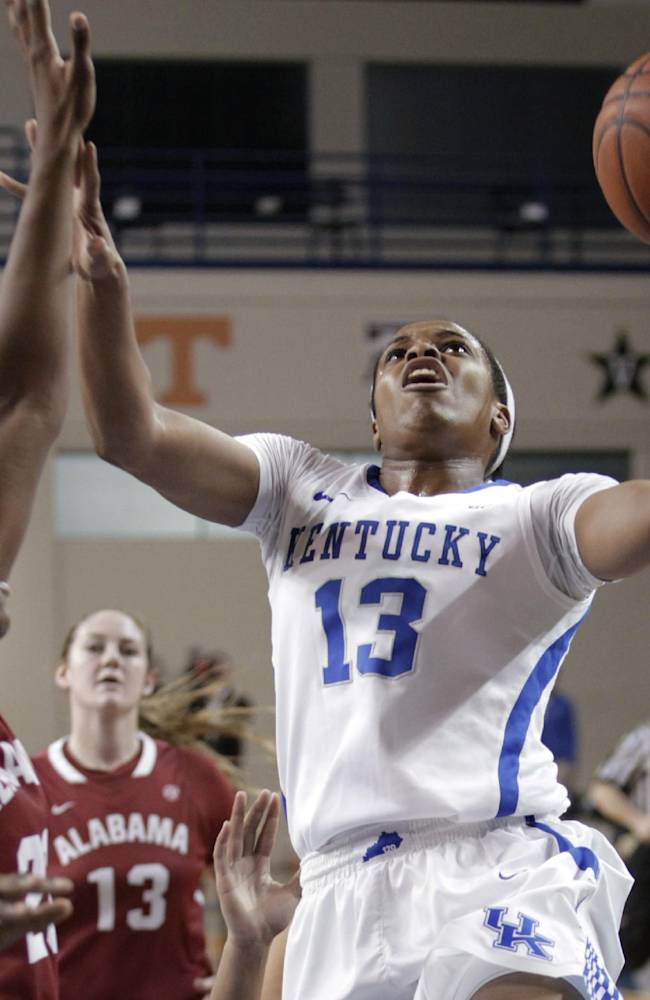 Kentucky's Bria Goss (13) shoots next to Alabama's Ashley Williams, left, during the first half of an NCAA college basketball game, Thursday, Jan. 23, 2014, in Lexington, Ky