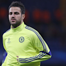 Chelsea's Cesc Fabregas warms prior to the Group G Champions League match between Chelsea and Maribor at Stamford Bridge stadium in London, Britain, Tuesday, Oct. 21, 2014