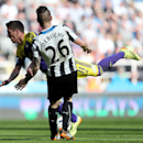 Newcastle United's Mathieu Debuchy, right, vies for the ball with Swansea City's Pablo Hernandez, left, during their English Premier League soccer match at St James' Park, Newcastle, England, Saturday, April 19, 2014