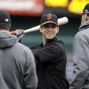 San Francisco Giants' Buster Posey takes batting practice before Game 5 of baseball's National League championship series against the St. Louis Cardinals Friday, Oct. 19, 2012, in St. Louis. (AP Photo/Mark Humphrey)