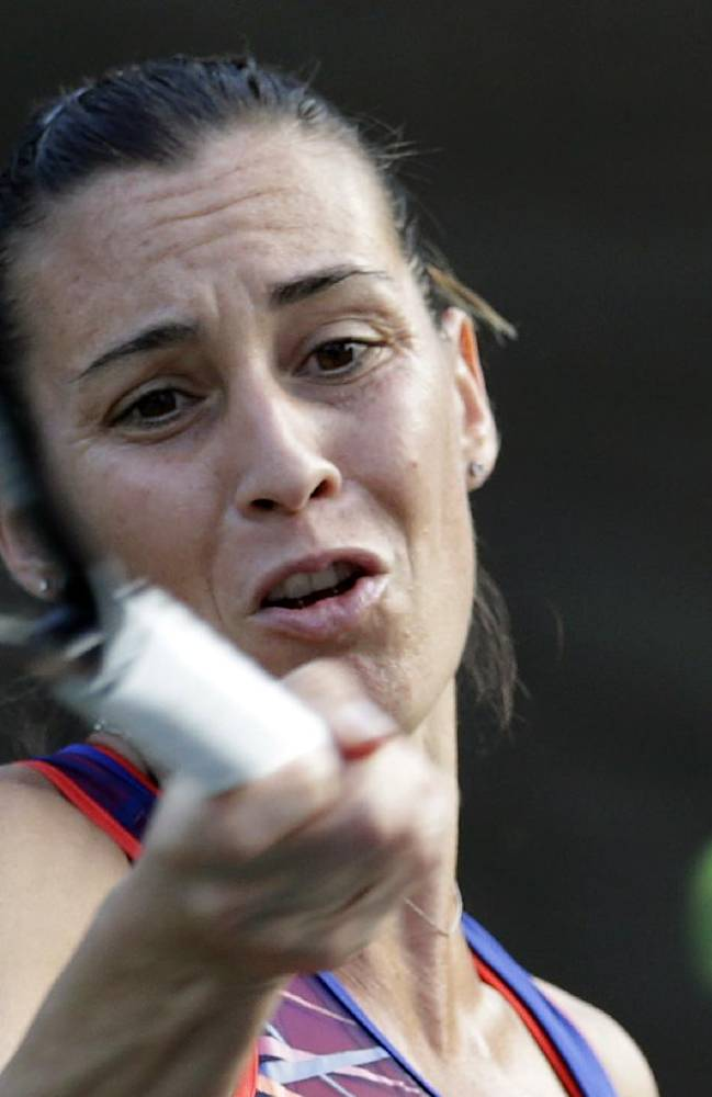 Flavia Pennetta of Italy returns a shot against Caroline Wozniacki of Denmark during their second round match of the Pan Pacific Open tennis tournament in Tokyo, Tuesday, Sept. 24, 2013