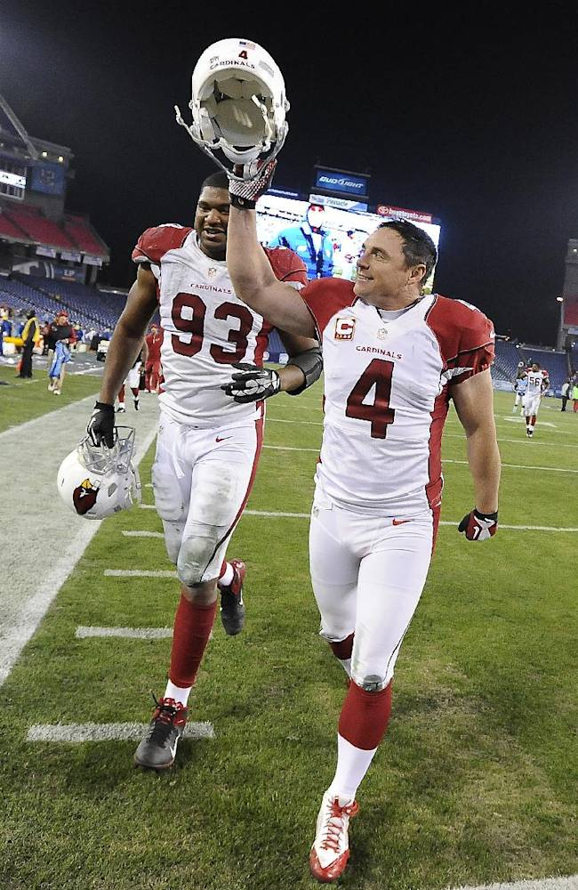 Arizona Cardinals kicker Jay Feely (4) leaves the field with defensive end Calais Campbell (93) after Feely kicked a 41-yard field goal in overtime against the Tennessee Titans to give the Cardinals a 37-34 win in an NFL football game Sunday, Dec. 15, 2013, in Nashville, Tenn