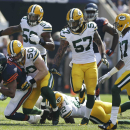 Chicago Bears running back Matt Forte (22) is tackled by Green Bay Packers inside linebacker A.J. Hawk (50) in the first half of an NFL football game Sunday, Sept. 28, 2014, in Chicago. The Associated Press