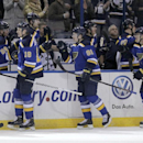 St. Louis Blues' Jay Bouwmeester (19) celebrates with teammates after scoring a goal in the first period of an NHL hockey game against the San Jose Sharks, Thursday, Jan. 8, 2015 in St. Louis The Associated Press