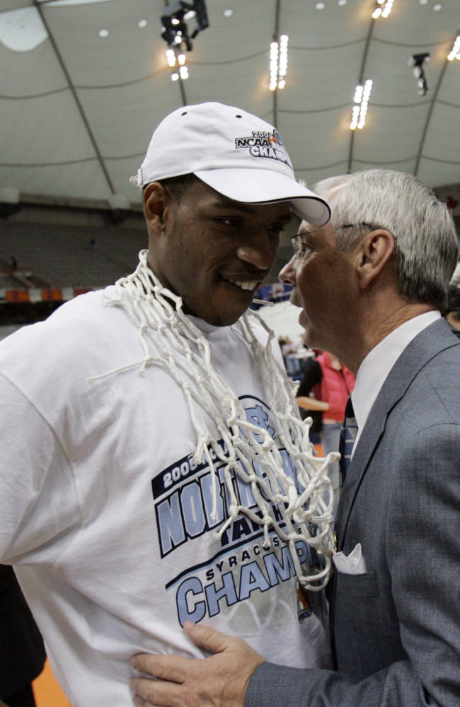 North Carolina coach Roy Williams chats with Rashad McCants after defeating Wisconsin 88-82 to win the NCAA East Regional in Syracuse, N.Y Sunday, March 27, 2005