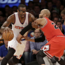 New York Knicks' Amar'e Stoudemire, left, drives around Chicago Bulls' Taj Gibson during the second half of the NBA basketball game, Sunday, April 13, 2014 in New York. The Knicks defeated the Bulls 100-89 The Associated Press