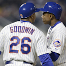 New York Mets first base coach Tom Goodwin, left, encourages Curtis Granderson, after Granderson struck out to end the sixth inning of a baseball game against the St. Louis Cardinals Tuesday, April 22, 2014, in New York The Associated Press