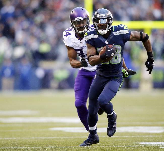 Seattle Seahawks' Walter Thurmond, right, is trailed by Minnesota Vikings' Cordarrelle Patterson as he runs for a touchdown after intercepting in the second half of an NFL football game Sunday, Nov. 17, 2013, in Seattle