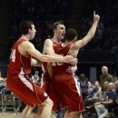 Wisconsin's Frank Kaminsky, left, and Sam Dekker, center, congratulate Traevon Jackson (12) after his three-point buzzer shot at the end of an NCAA college basketball game against Penn State in State College, Pa., Sunday, March 10, 2013. Wisconsin won 63-60. (AP Photo/Ralph Wilson)