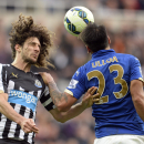Newcastle United's Fabricio Coloccini, left, and Leicester City's Leonardo Ulloa battle for the ball during their English Premier League soccer match at St. James' Park, Newcastle, England, Saturday, Oct. 18, 2014