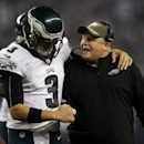 Philadelphia Eagles' Mark Sanchez (3) celebrates with head coach Chip Kelly after LeSean McCoy scored on a running play during the second half of an NFL football game against the Dallas Cowboys, Thursday, Nov. 27, 2014, in Arlington, Texas The Associated