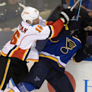 Calgary Flames' Brian McGrattan (16) checks St. Louis Blues' Barret Jackman, right, during the second period of an NHL hockey game, Saturday, Oct. 11, 2014, in St. Louis The Associated Press
