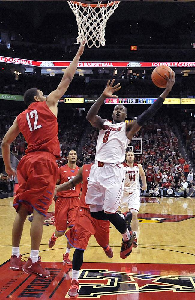Louisville's Terry Rozier (0) goes in for a layup past the defense of SMU's Nick Russell (12) during the second half of an NCAA college basketball game Sunday Jan. 12, 2014, in Louisville, Ky. Louisville defeated SMU 71-63